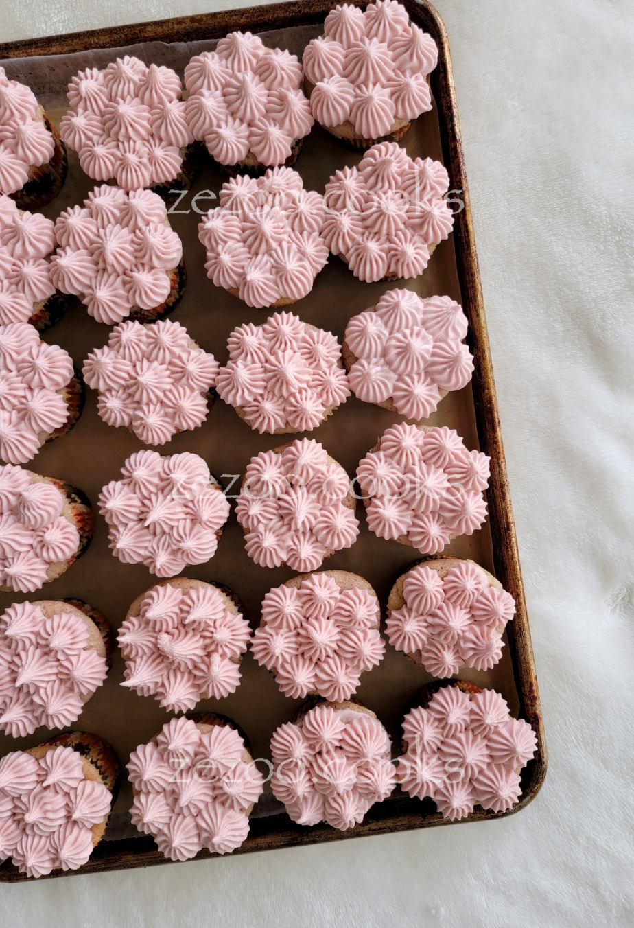 Strawberry cupcakes with strawberry cream cheesefrosting