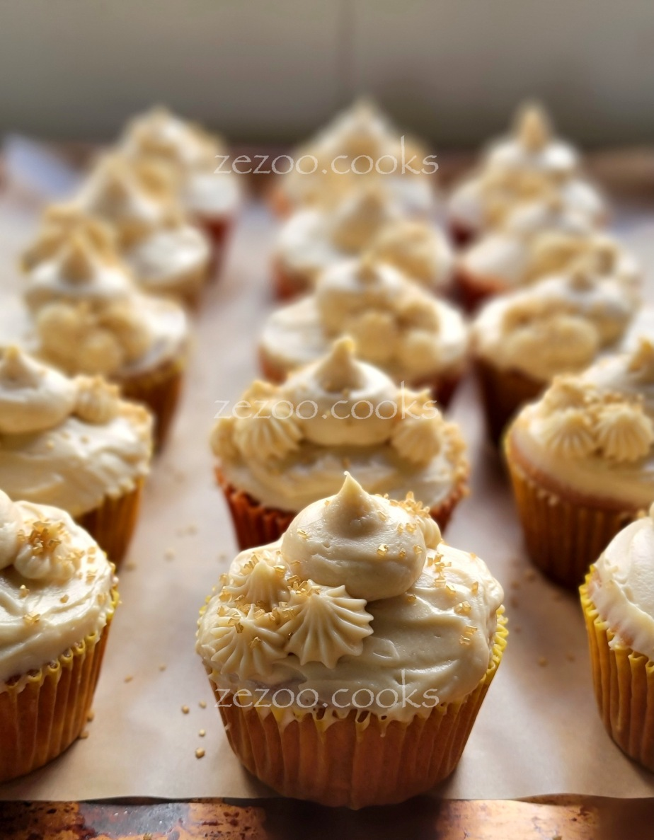Peach cupcakes with brown sugar cream cheesefrosting